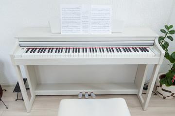 White piano in classroom
