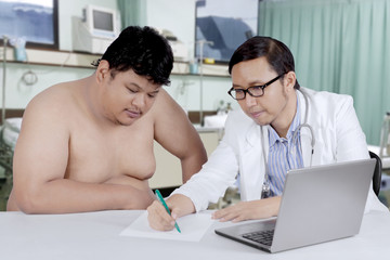 Doctor talking to an overweight patient