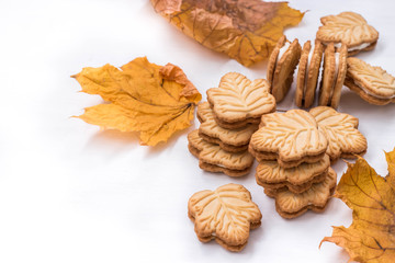canadian butter cookies with maple syrup on white background