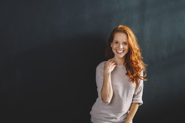 Happy vivacious young redhead woman