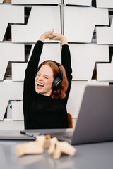 Happy excited woman listening to music