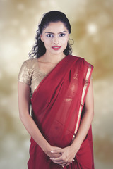 confident indian woman over blurred background