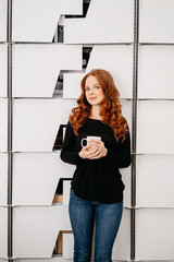 Young attractive woman relaxing with coffee