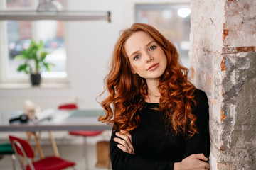 Serious beautiful attentive young redhead woman