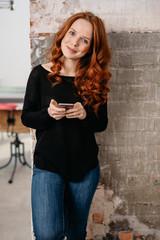 Pretty slender redhead woman smiling