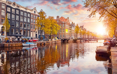 Fotobehang Amsterdam Channel in Amsterdam Netherlands houses river Amstel landmark