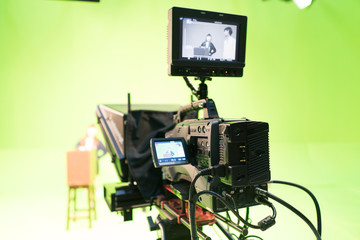Green screen studio with camera equipment