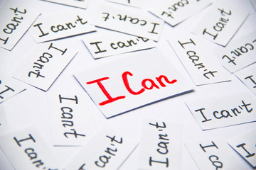 I can. Words of motivation. Concept motivational message of ability and possibility. I can`t and i can are written on peaces of white paper.