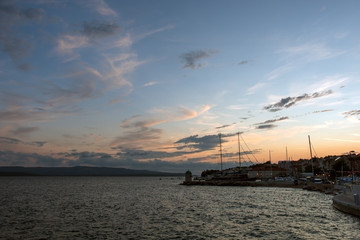 View of the Bol port in the island of Brac, Croatia, evening at sunset