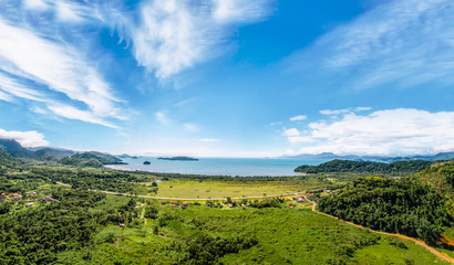 View over in the Paraty, the beach and blue ocean. Green forest