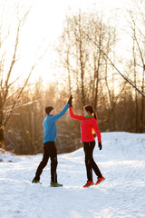 Photo of sports girl and man doing winter park in afternoon