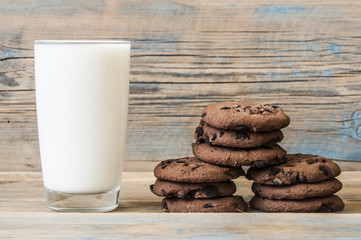 Tasty chocolate cookies with glass of milk