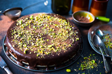 Homemade Chocolate Cake with Dark Chocolate Glaze and Pistachios Nuts