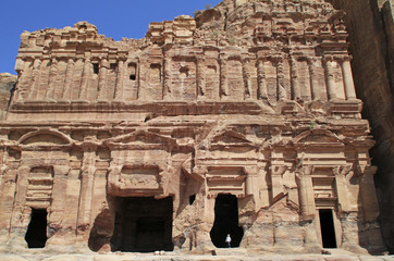 Man standing in the entrance of a giant building in Petra, Jordan