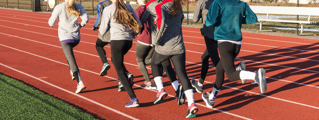 Group of young girls running on a track
