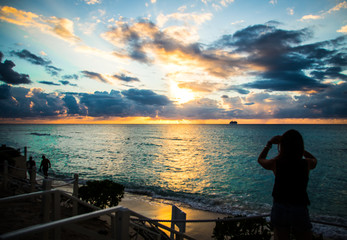 Girl Taking Photo of Caribbean Sunset