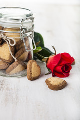 Heart-shaped cookies in a glass jar