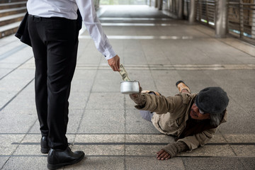 Man give money to handicapped homeless beggar