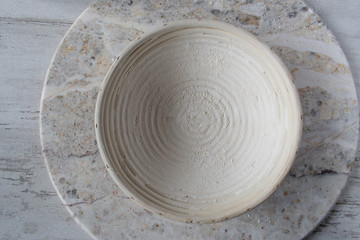 bread proofing basket with rings with floured surface top view