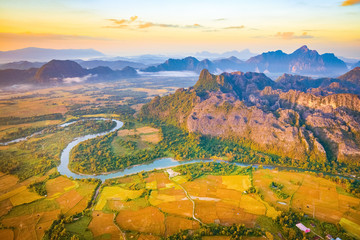 Aerial view of the fields, river and mountain. Beautiful landscape. Laos.