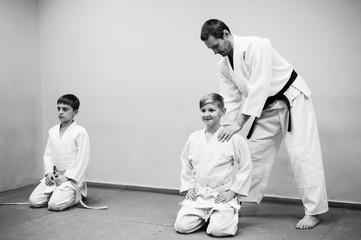 Children in kimono begin training on aikido