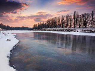 beautiful sunset on the frozen river
