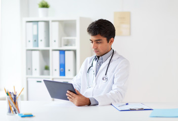 doctor with tablet pc and stethoscope at clinic