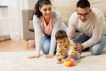 happy family and baby daugter playing at home
