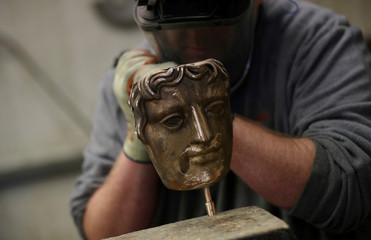 Mould frames are seen during the manufacturing process of a British Academy of Film and Television Awards (BAFTA) mask at a foundry in west London