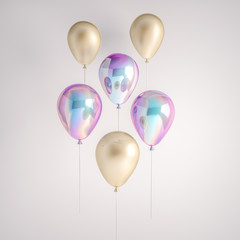 Set of iridescence holographic and gold foil balloons isolated on gray background. Trendy realistic design 3d elements for birthday, presentation, promo, party or other events.