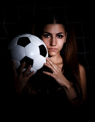 Young woman with a football