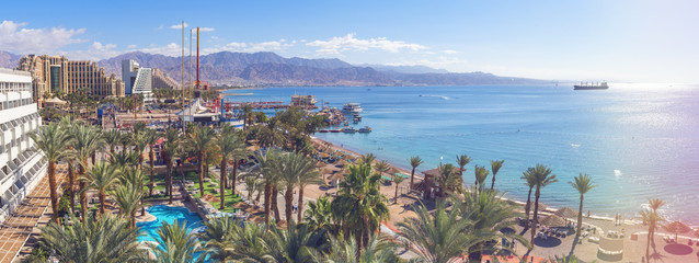 Central public beach and marina in Eilat - famous resort and recreation city in Israel. This serene location is a very popular tropical getaway for Israeli and European tourists. Panoramic view