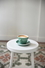 Cup of coffee of side table
