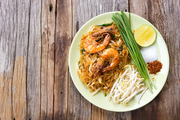 Fried noodle with prawns. Favorite Thai food. Local name, Pad Thai. Top view with copy space.