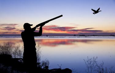 cazador en el paisaje