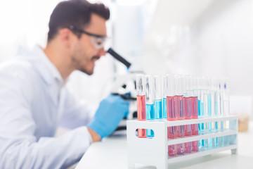 Pleasant male laboratorian conducting research