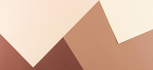 Color papers geometry composition banner background with pink, beige and brown tones.