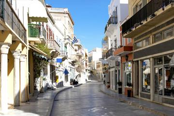 Narrow stone street and buildings in Siros island. Greece.