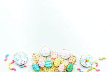 Sweets, pastry for Easter table. Easter eggs and Easter bunny concept. White background top view space for text