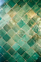 Green Moroccan Arabic tiles pattern on a wall