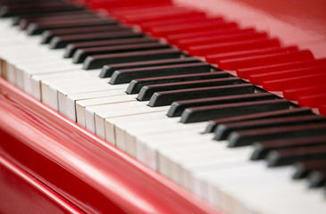 Close up view of red piano keys