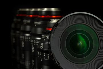 Professional Cinema Lens - concept of camera lenses on the mirroring black background.