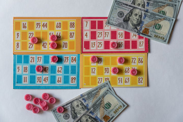 Colorful lotto or bingo game papers with numbers.
