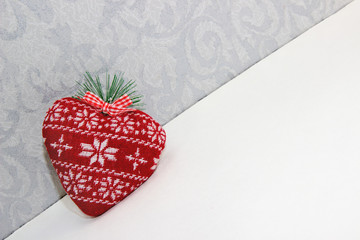 Red tissue toy heart with pattern on background