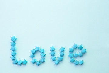 "word ""love"" written by means of small paper stars"
