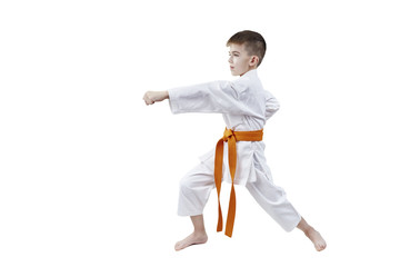 With an orange belt, a small sportsman is beating blow hand
