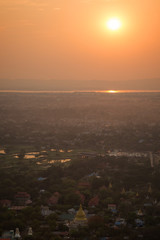 Beautiful sunset in Mandalay, Myanmar (Burma), viewed from above from the Mandalay Hill. Copy space.