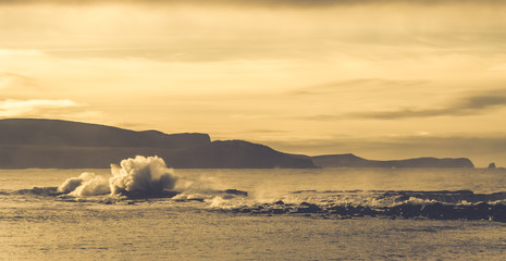 Rough sea and big waves in sepia