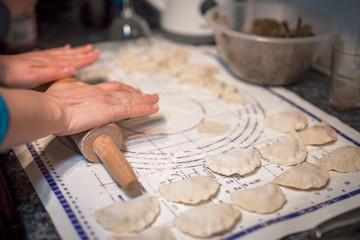 Woman preparing pierogi in the kitchen