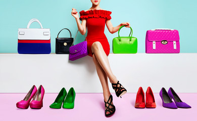 Beautiful legs woman sitting with many bags and shoes. Colourful fashion image.